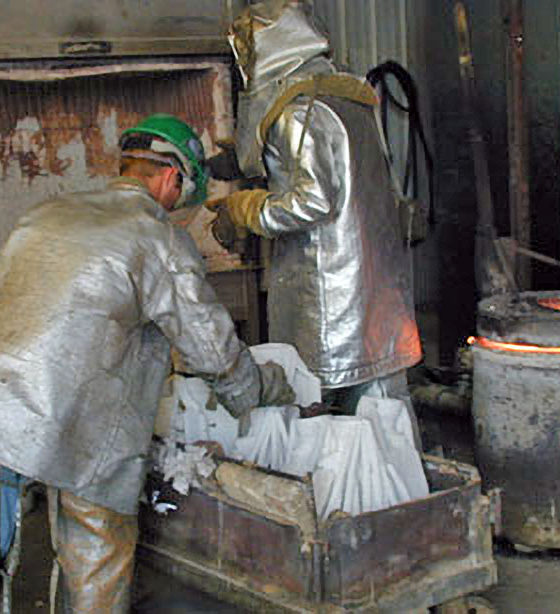 Ceramic shell molds are pulled from the heat-up kiln at 1200 to 1500 degrees just prior to being poured.