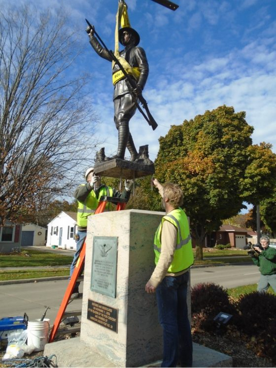 Installing the bronze doughboy in Appleton, WI 2017