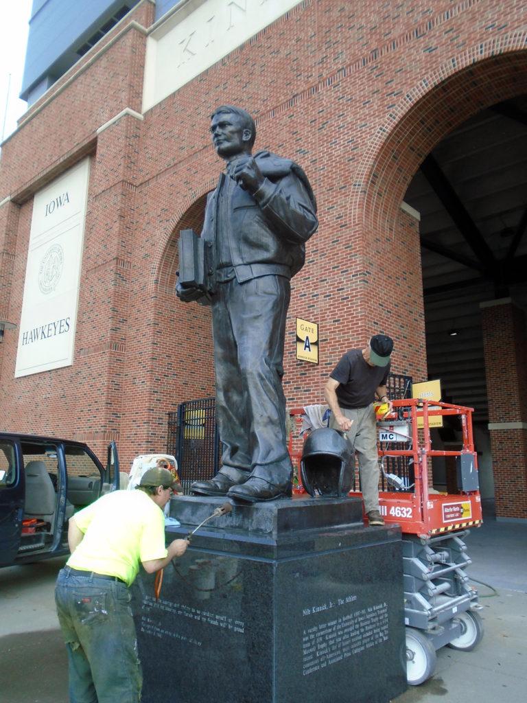 Cleaning Nile Kinnick statue, University of Iowa, Max-Cast