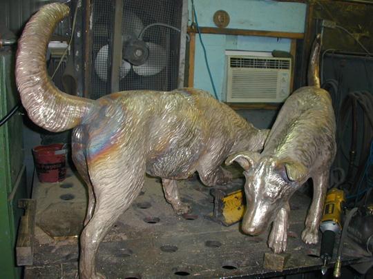 Commission DeWitt, Iowa Screetscape sculptures dogs welded, Doris Park, 2010